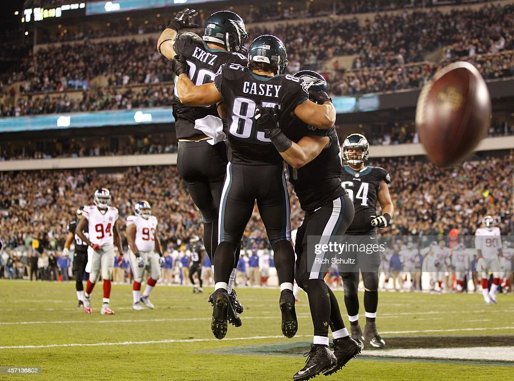 James Casey #85 of the Philadelphia Eagles celebrates his touchdown catch against the New York Giants with teammates <a gi-track='captionPersonalityLinkClicked' href=/galleries/search?phrase=Zach+Ertz&family=editorial&specificpeople=7172878 ng-click='$event.stopPropagation()'>Zach Ertz</a> #86 and <a gi-track='captionPersonalityLinkClicked' href=/galleries/search?phrase=Brent+Celek&family=editorial&specificpeople=2557212 ng-click='$event.stopPropagation()'>Brent Celek</a> #87 during the second quarter in a football game at Lincoln Financial Field on October 12, 2014 in Philadelphia, Pennsylvania.