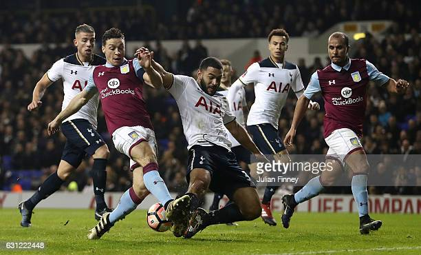 James Chester of Aston Villa attempts to shoot but has his shot blocked by Cameron CarterVickers of Tottenham Hotspur during The Emirates FA Cup...