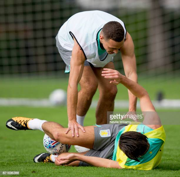 James Chester of Aston Villa in action with team mate Jack Grealish during an Aston Villa training session at the club's training camp at Guetersloh...