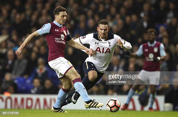 James Chester of Aston Villa passes the ball while under pressure from Vincent Janssen of Tottenham Hotspur during The Emirates FA Cup Third Round...