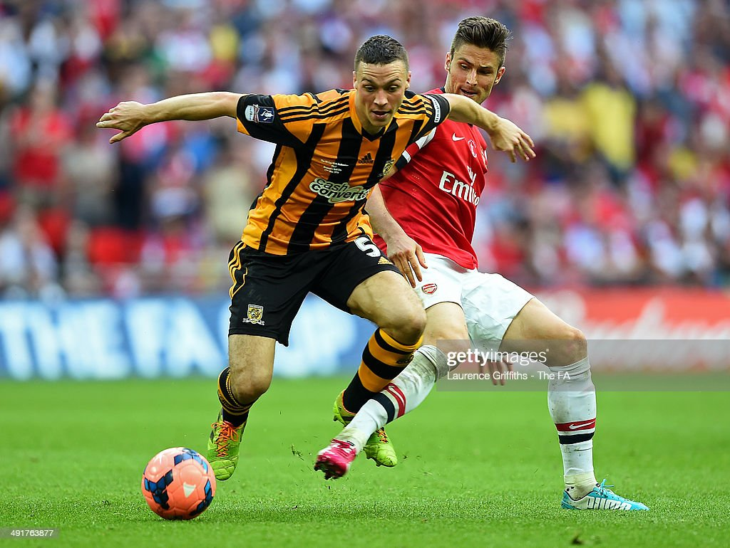James Chester of Hull City battles for the ball with Olivier Giroud of Arsenal during the FA Cup with Budweiser Final match between Arsenal and Hull City at Wembley Stadium on May 17, 2014 in London, England.