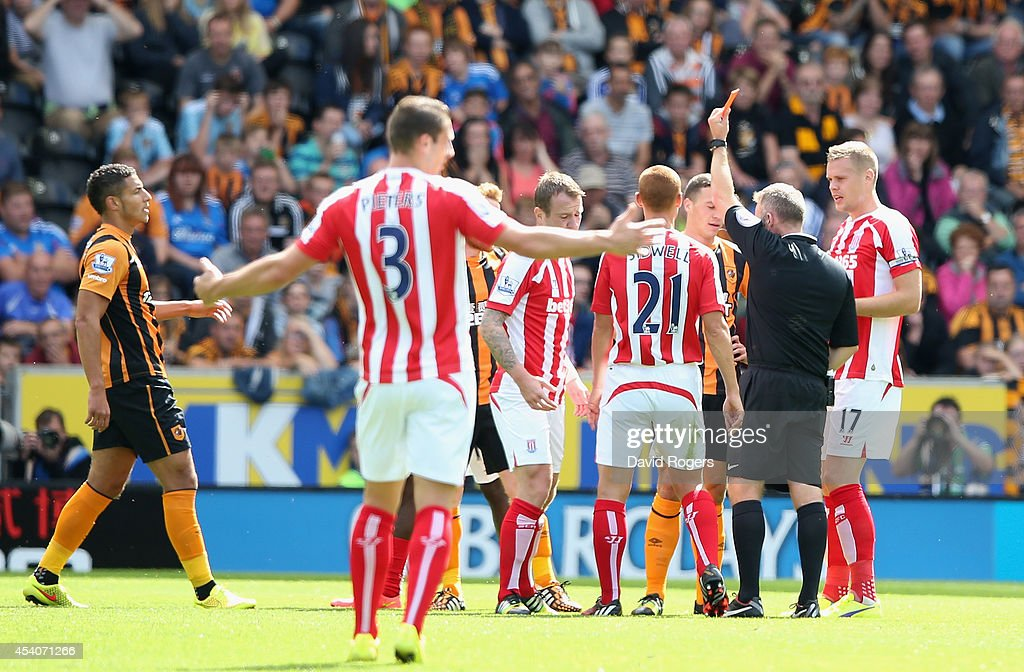 <a gi-track='captionPersonalityLinkClicked' href=/galleries/search?phrase=James+Chester&family=editorial&specificpeople=4192570 ng-click='$event.stopPropagation()'>James Chester</a> of Hull City is sent off by referee J. Moss during the Barclays Premier League match between Hull City and Stoke City at the KC Stadium on August 24, 2014 in Hull, England.