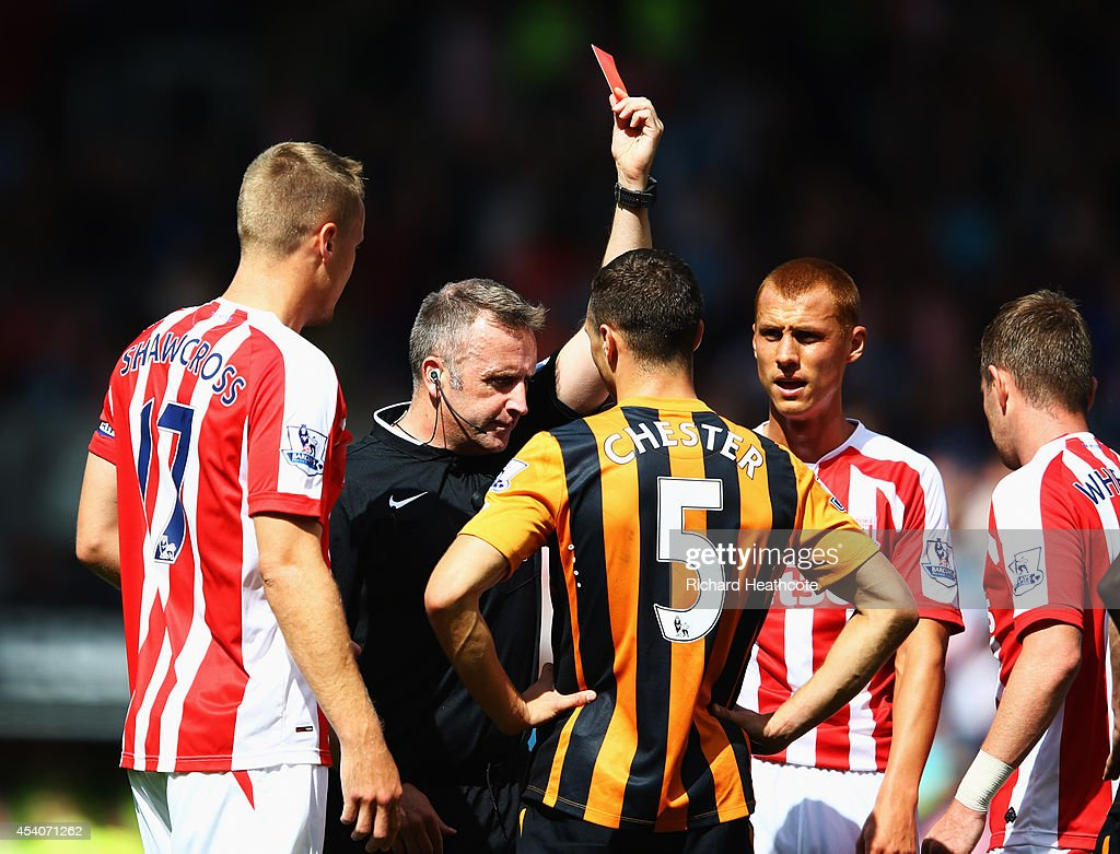 <a gi-track='captionPersonalityLinkClicked' href=/galleries/search?phrase=James+Chester&family=editorial&specificpeople=4192570 ng-click='$event.stopPropagation()'>James Chester</a> of Hull City (5) is show a red card by referee Jonathan Moss and is sent off during the Barclays Premier League match between Hull City and Stoke City at KC Stadium on August 24, 2014 in Hull, England.