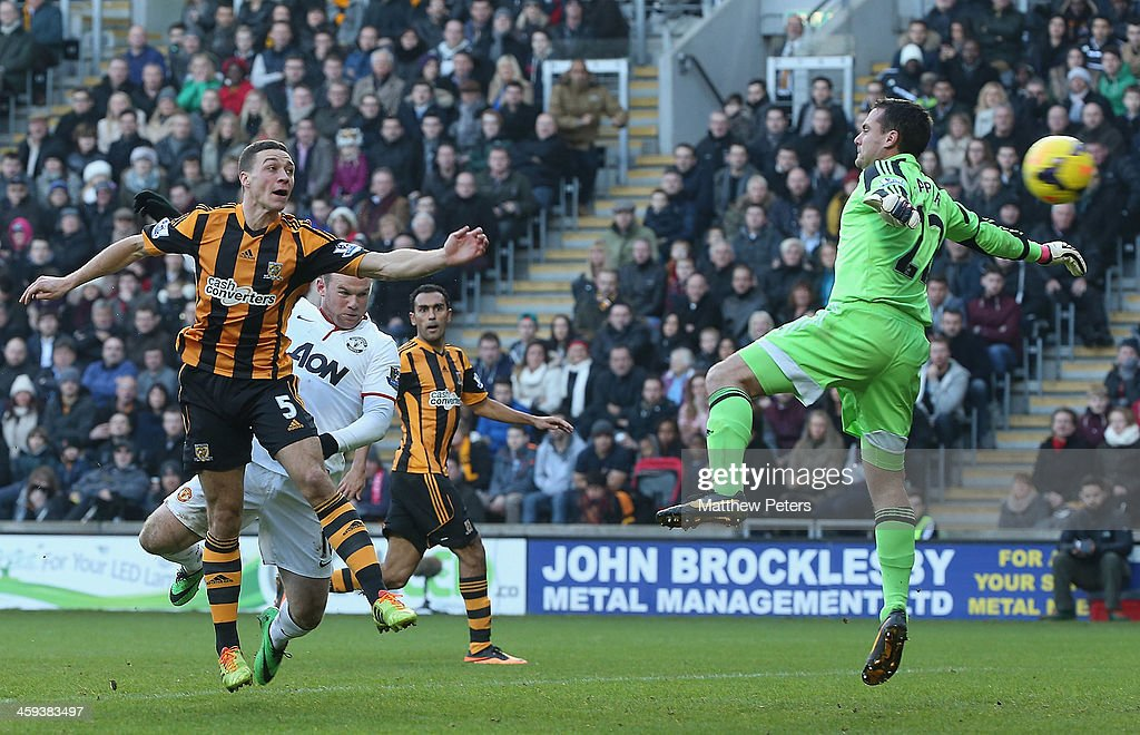 James Chester of Hull City scores an own goal during the Barclays Premier League match between Hull City and Manchester United at KC Stadium on December 26, 2013 in Hull, England.