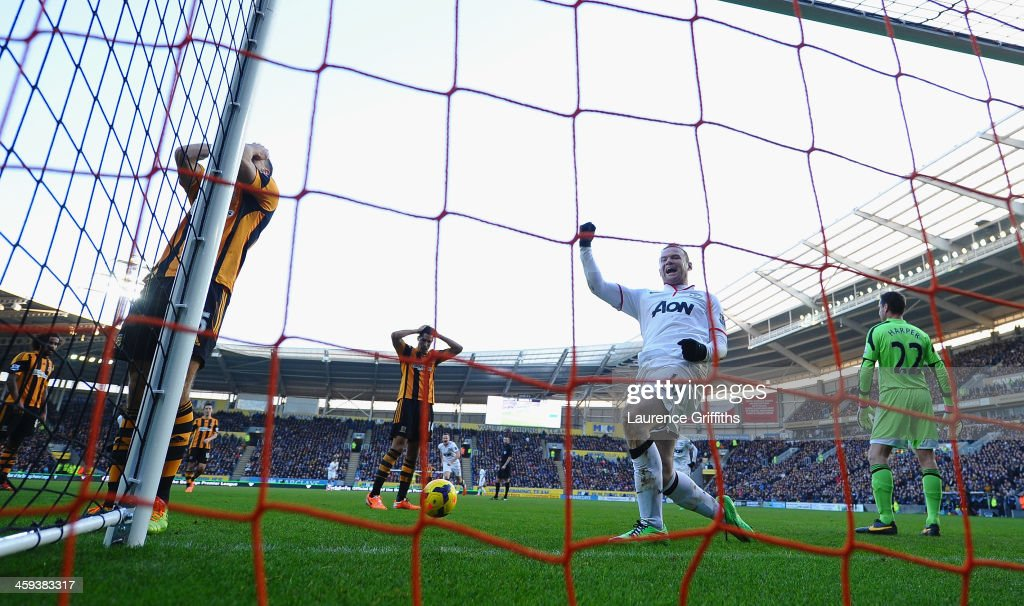 <a gi-track='captionPersonalityLinkClicked' href=/galleries/search?phrase=James+Chester&family=editorial&specificpeople=4192570 ng-click='$event.stopPropagation()'>James Chester</a> of Hull scores an own goal in front of <a gi-track='captionPersonalityLinkClicked' href=/galleries/search?phrase=Wayne+Rooney&family=editorial&specificpeople=157598 ng-click='$event.stopPropagation()'>Wayne Rooney</a> of Manchester United during the Barclays Premier League match between Hull City and Manchester United at KC Stadium on December 26, 2013 in Hull, England.