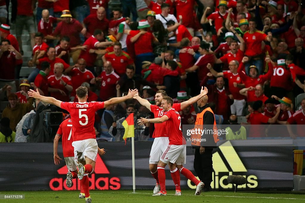 James Chester of Wales, Chris Gunter of Wales, Sam Vokes of Wales celebrates scoring 3-1 during the UEFA EURO 2016 quarter final match between Wales and Belgium on July 2, 2016 at the Stade Pierre Mauroy in Lille, France.