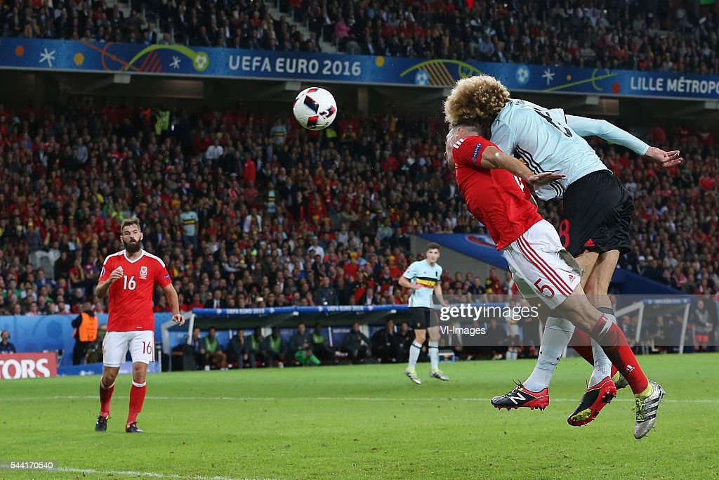 James Chester of Wales, Marouane Fellaini of Belgium during the UEFA EURO 2016 quarter final match between Wales and Belgium on July 2, 2016 at the Stade Pierre Mauroy in Lille, France.
