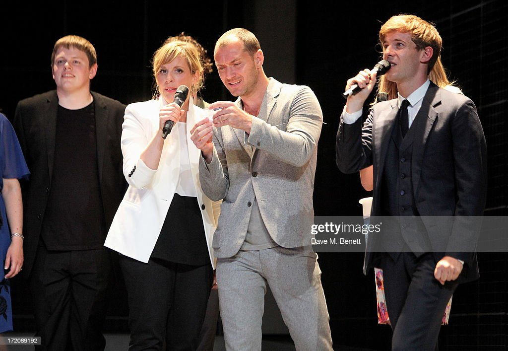 James Christy, Mel Giedroyc, Jude Law and Luke Treadaway speak on stage at 'A Curious Night at the Theatre', a charity gala evening to raise funds for Ambitious about Autism and The National Autistic Society, at The Apollo Theatre on July 1, 2013 in London, England.