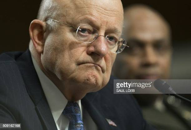 James Clapper director of National Intelligence and Marine Corps Lt Gen Vincent Stewart director of the Defense Intelligence Agency testify during a...