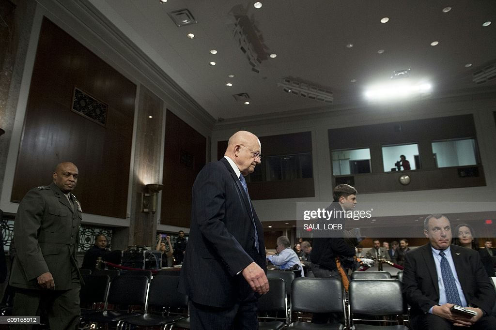 James Clapper, director of National Intelligence, arrives to testify during a Senate Armed Services Committee hearing on Capitol Hill in Washington, DC, February 9, 2016. The global threat posed by the Islamic State group is still rising but US-based homegrown extremists pose the biggest danger to the homeland, Washington's top spy said February 9. In a report prepared for US lawmakers before he was due to address a Senate panel, Director of National Intelligence James Clapper said US-based extremists pose 'the most significant Sunni terrorist threat.' / AFP / Saul LOEB