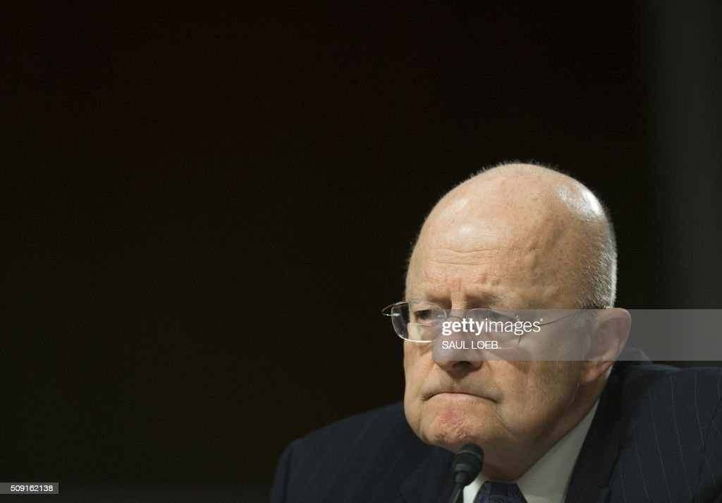James Clapper, director of National Intelligence, testifies during a Senate Armed Services Committee hearing on Capitol Hill in Washington, DC, February 9, 2016. The global threat posed by the Islamic State group is still rising but US-based homegrown extremists pose the biggest danger to the homeland, Washington's top spy said February 9. In a report prepared for US lawmakers before he was due to address a Senate panel, Director of National Intelligence James Clapper said US-based extremists pose 'the most significant Sunni terrorist threat.' / AFP / Saul LOEB