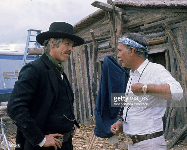 James Coburn US actor in costume and Sam Peckinpah US film director on the set of the film 'Pat Garrett and Billy the Kid' USA 1973 The western...