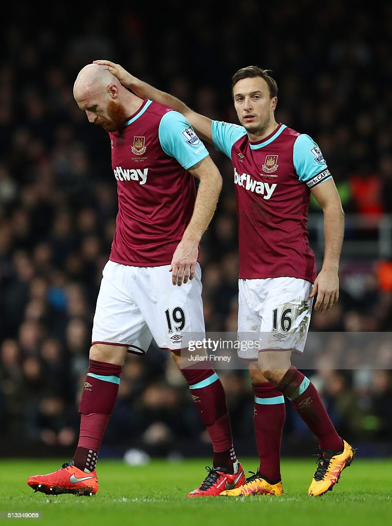 James Collins is consoled by Mark Noble of West Ham United as he is substituted during the Barclays Premier League match between West Ham United and Tottenham Hotspur at Boleyn Ground on March 2, 2016 in London, England.