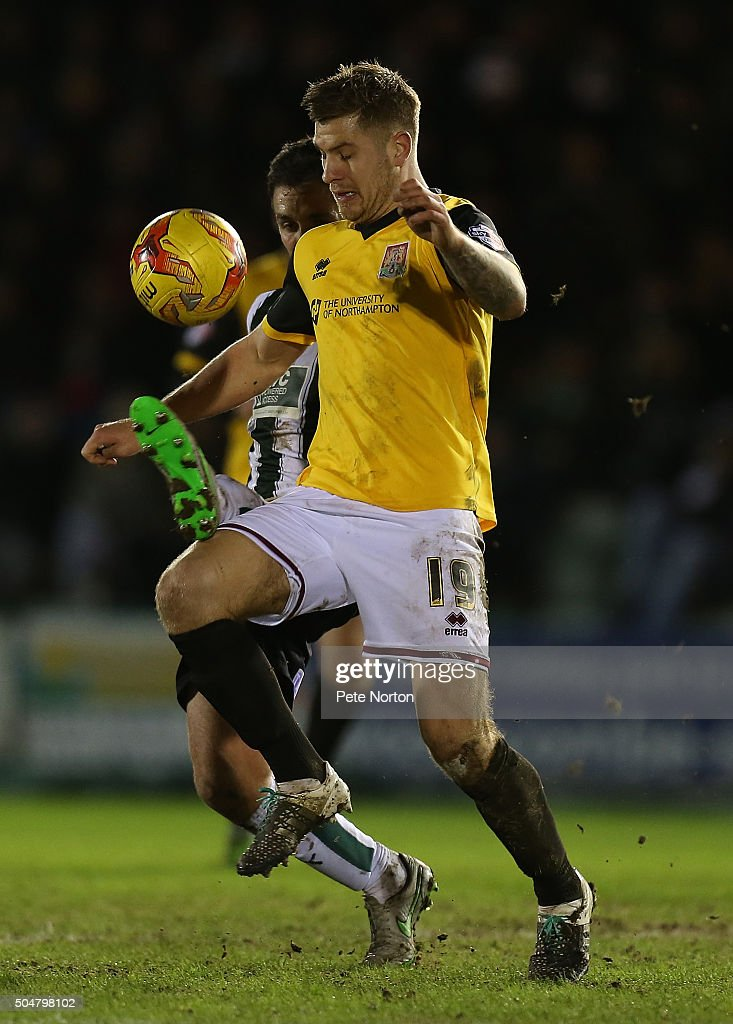James Collins of Northampton Town attempts to control the ball under pressure from Carl McHugh of Plymouth Argyle during the Sky Bet League Two match between Plymouth Argyle and Northampton Town at Home Park on January 12, 2016 in Plymouth, England.