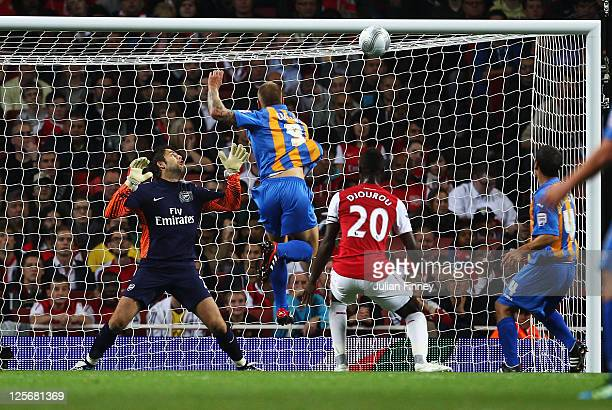 James Collins of Shrewsbury Town scores their first goal with a header as golakeeper Lukasz Fabianski of Arsenal looks on during the Carling Cup...