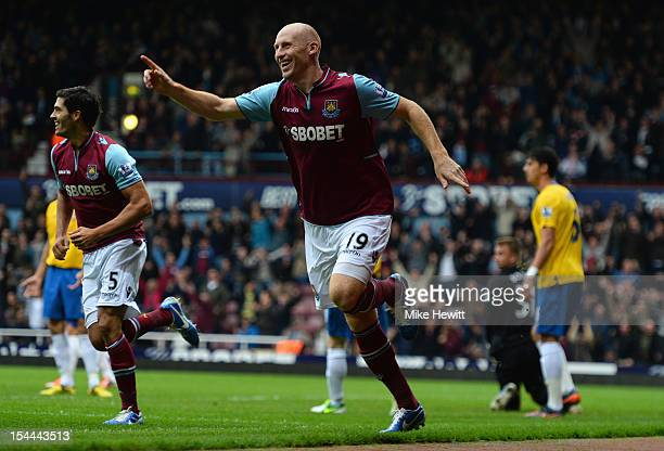 James Collins of West Ham celebrates after a free kick from team mate Mark Noble ends up in the goal during the Barclays Premier League match between...