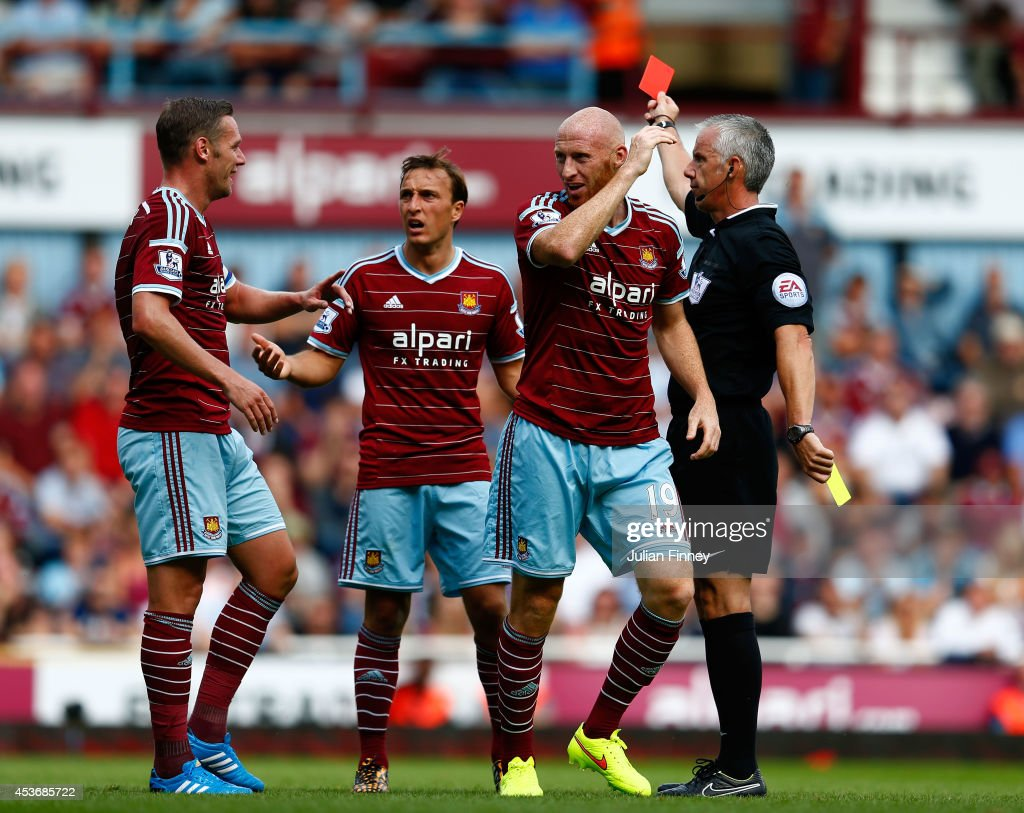 James Collins of West Ham reacts after receiving the red card for his second bookable offence during the Barclays Premier League match between West Ham United and Tottenham Hotspur at Boleyn Ground on August 16, 2014 in London, England.