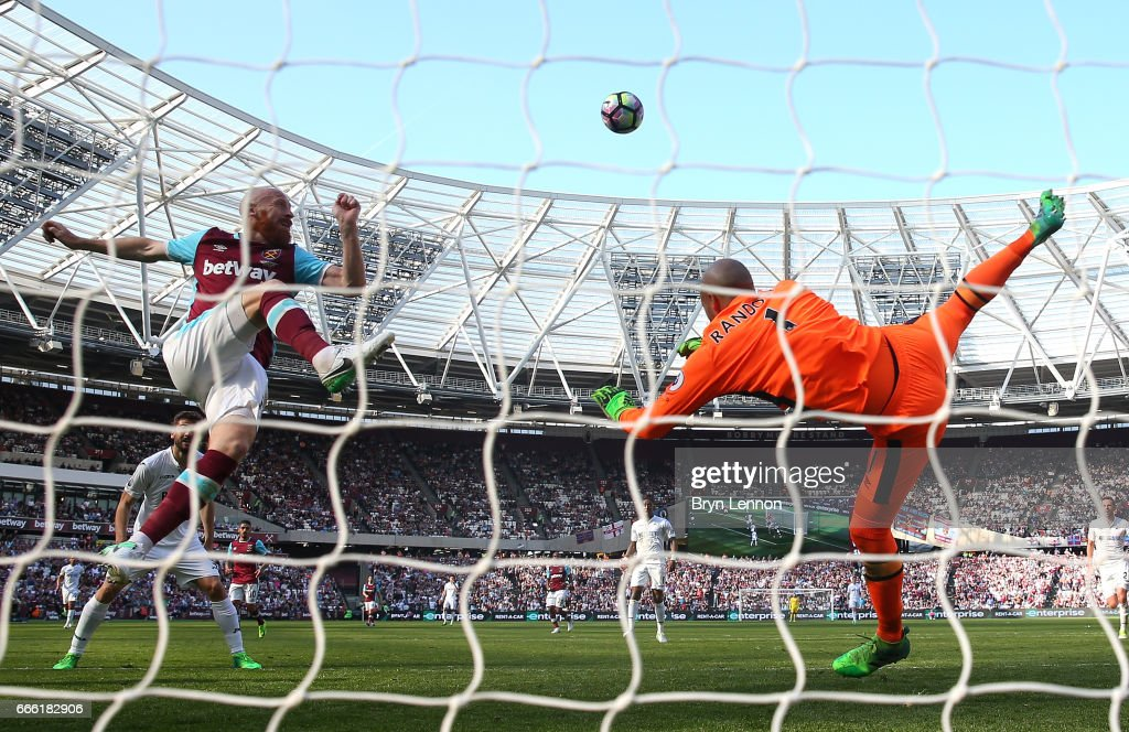 James Collins of West Ham Unitd clears the ball during the Premier League match between West Ham United and Swansea City at London Stadium on April 8, 2017 in Stratford, England.