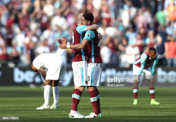 James Collins of West Ham United and Jose Fonte of West Ham United embrace after the Premier League match between West Ham United and Swansea City at...