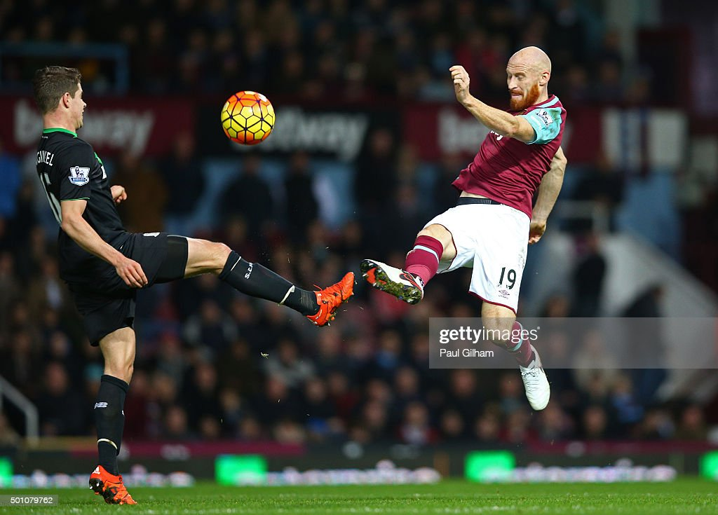 James Collins of West Ham United and Marco van Ginkel of Stoke City compete for the ball during the Barclays Premier League match between West Ham United and Stoke City at the Boleyn Ground on December 12, 2015 in London, United Kingdom.