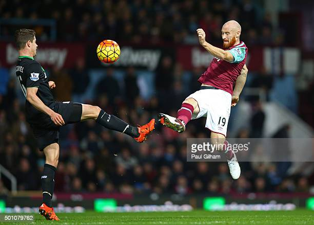James Collins of West Ham United and Marco van Ginkel of Stoke City compete for the ball during the Barclays Premier League match between West Ham...