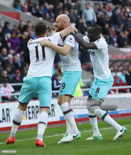 James Collins of West Ham United celebrates scoring his sides second goal with Robert Snodgrass of West Ham United and Cheikhou Kouyate of West Ham...
