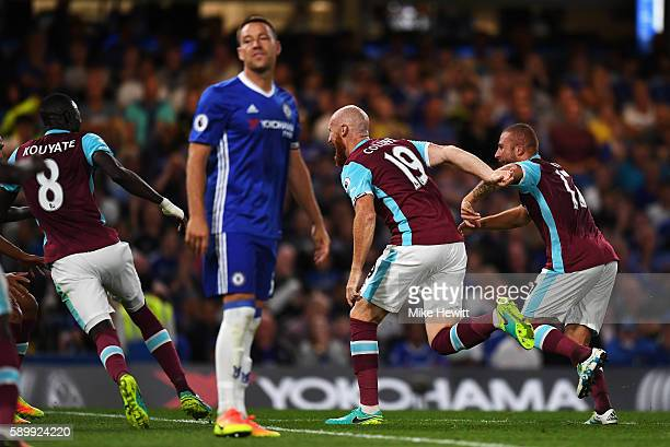 James Collins of West Ham United celebrates scoring his team's opening goal as John Terry of Chelsea reacts during the Premier League match between...