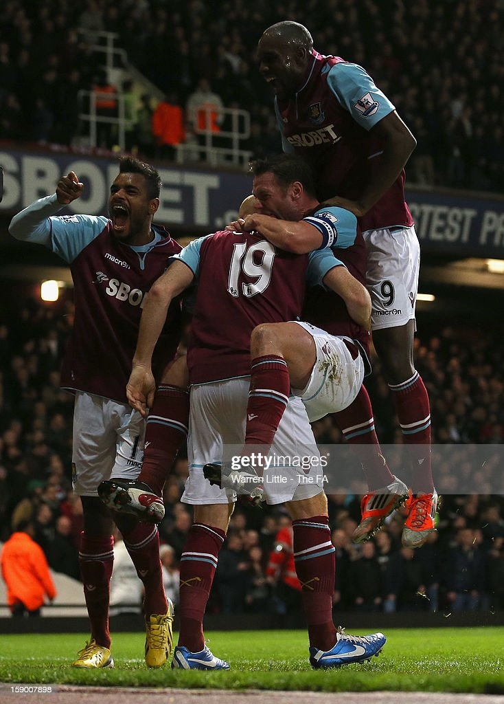 <a gi-track='captionPersonalityLinkClicked' href=/galleries/search?phrase=James+Collins+-+Welsh+Soccer+Player&family=editorial&specificpeople=15167252 ng-click='$event.stopPropagation()'>James Collins</a> of West Ham United (19) celebrates scoring the equalizing goal with team mates <a gi-track='captionPersonalityLinkClicked' href=/galleries/search?phrase=Ricardo+Vaz+Te&family=editorial&specificpeople=645494 ng-click='$event.stopPropagation()'>Ricardo Vaz Te</a>, <a gi-track='captionPersonalityLinkClicked' href=/galleries/search?phrase=Kevin+Nolan&family=editorial&specificpeople=206775 ng-click='$event.stopPropagation()'>Kevin Nolan</a> and <a gi-track='captionPersonalityLinkClicked' href=/galleries/search?phrase=Carlton+Cole&family=editorial&specificpeople=215313 ng-click='$event.stopPropagation()'>Carlton Cole</a> during the FA Cup with Budweiser Third Round match between West Ham United and Manchester United at the Boleyn Ground on January 5, 2013 in London, England.