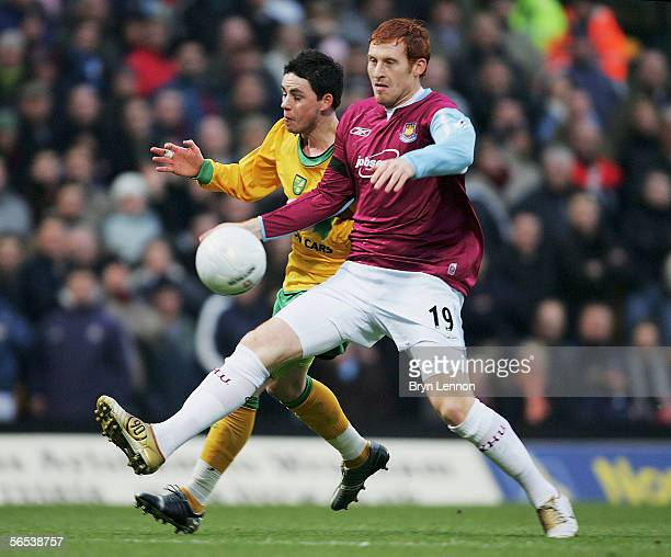 James Collins of West Ham United challenges Ian Henderson of Norwich City during the FA Cup Third Round match between Norwich City and West Ham...