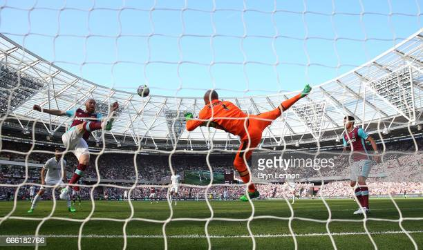 James Collins of West Ham United clears the ball during the Premier League match between West Ham United and Swansea City at London Stadium on April...