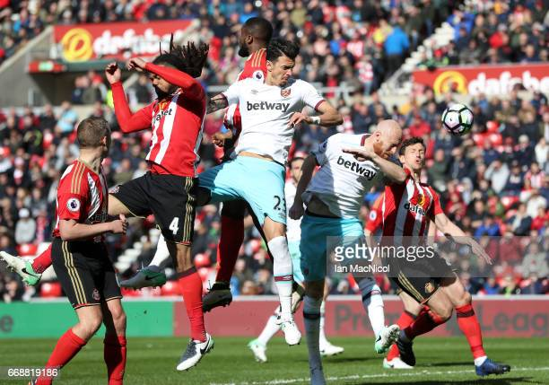 James Collins of West Ham United scores his sides second goal during the Premier League match between Sunderland and West Ham United at Stadium of...