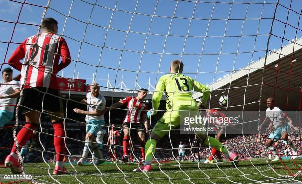 James Collins of West Ham United scores his sides second goal past Jordan Pickford of Sunderland during the Premier League match between Sunderland...