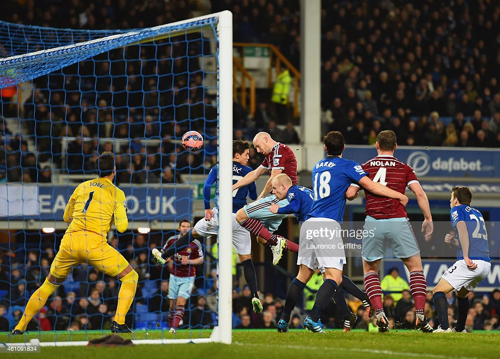 James Collins of West Ham United (C) scores their first goal with a header past goalkeeper Joel Robles of Everton during the FA Cup Third Round match between Everton and West Ham United at Goodison Park on January 6, 2015 in Liverpool, England.