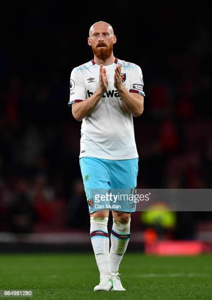 James Collins of West Ham United shows appreciation to the fans after the Premier League match between Arsenal and West Ham United at the Emirates...