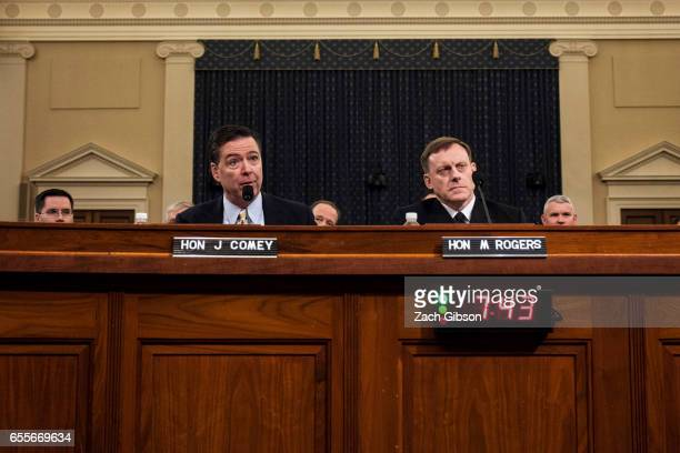 James Comey Director of the Federal Bureau of Investigation and Michael Rogers Director of the National Security Agency testify during a House...