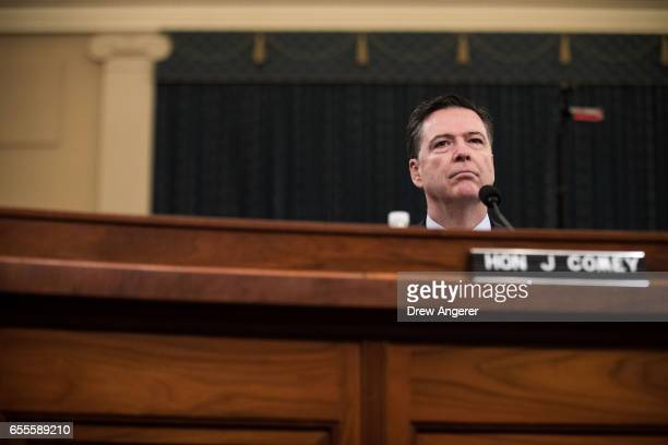 James Comey Director of the Federal Bureau of Investigation listens to opening statements from the chairman during a House Permanent Select Committee...