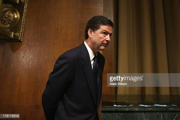 James Comey Jr nominee to be director of the Federal Bureau of Investigation arrives for his Senate Judiciary Committee confirmation hearing on...