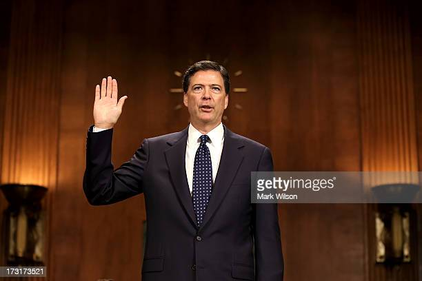 James Comey Jr nominee to be director of the Federal Bureau of Investigation is sworn in for his Senate Judiciary Committee confirmation hearing on...