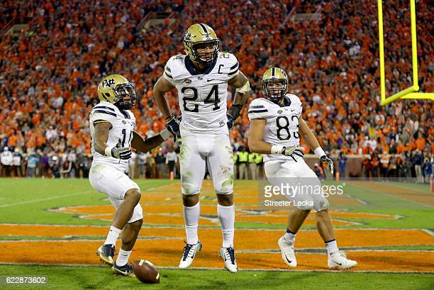 James Conner celebrates after scoring a touchdown with teammates Quadree Henderson and Scott Orndoff of the Pittsburgh Panthers during their game...