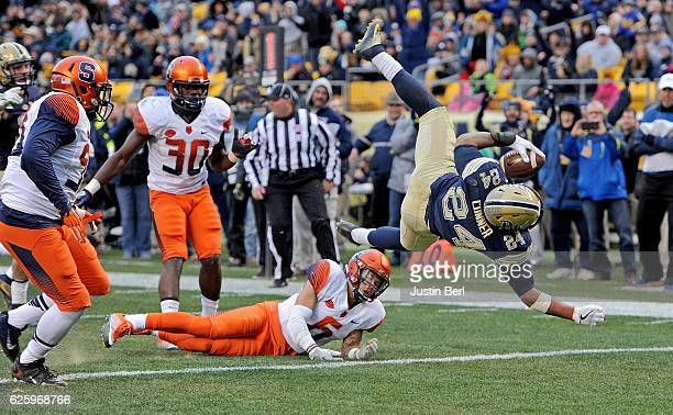 James Conner of the Pittsburgh Panthers is upended by Rodney Williams of the Syracuse Orange as he rushes for a 9 yard touchdown in the second...