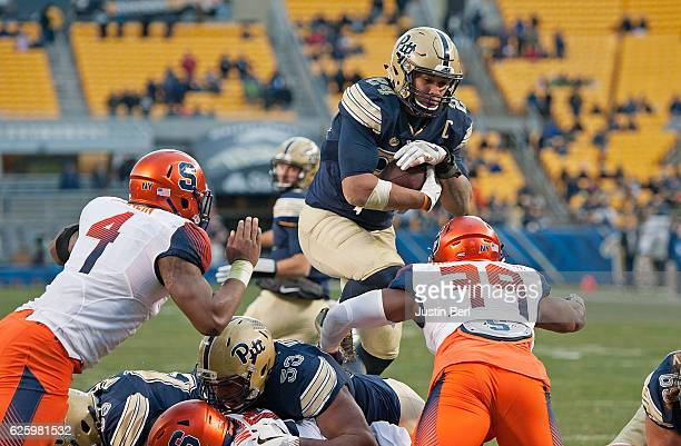 James Conner of the Pittsburgh Panthers leaps into the end zone for a 1 yard touchdown run in the fourth quarter during the game against the Syracuse...