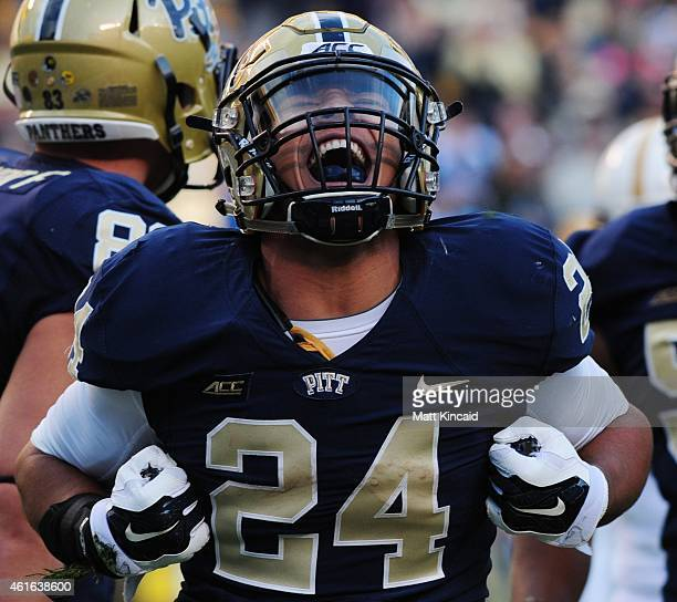 James Conner of the Pittsburgh Panthers reacts after scoring a touchdown against the Georgia Tech Yellow Jackets during the game at Heinz Field on...