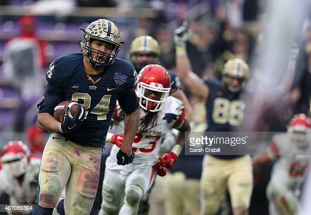 James Conner of the Pittsburgh Panthers runs for a touchdown during the Lockheed Martin Armed Forces Bowl game against the Houston Cougars at Amon G...