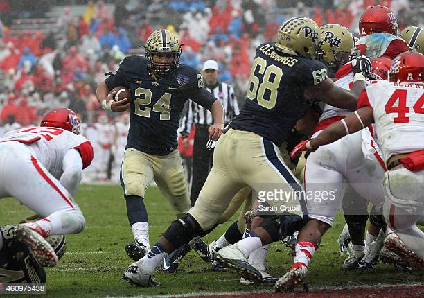 James Conner of the Pittsburgh Panthers runs two yards for a touchdown during the Lockheed Martin Armed Forces Bowl game against the Houston Cougars...
