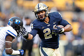 James Conner of the Pittsburgh Panthers runs with the ball during the game against the Duke Blue Devils at Heinz Field on November 1 2014 in...