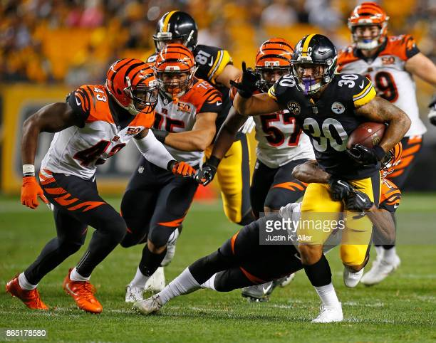 James Conner of the Pittsburgh Steelers carries the ball against the Cincinnati Bengals in the fourth quarter during the game at Heinz Field on...