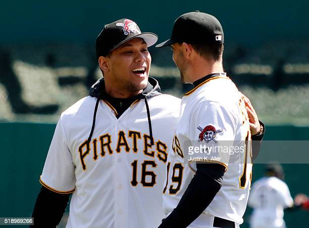 James Conner talks with Chris Stewart of the Pittsburgh Pirates after throwing out the first pitch before opening day between the St Louis Cardinals...