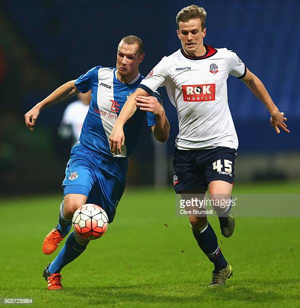 James Constable of Eastleigh and Rob Holding of Bolton Wanderers compete for the ball during the Emirates FA Cup Third Round Replay match between...