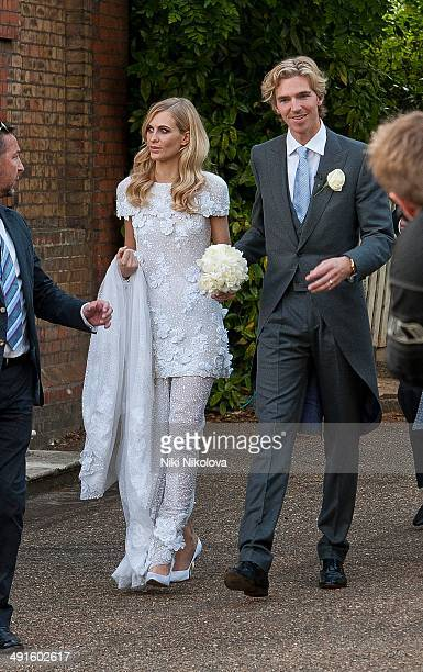 James Cook and Poppy Delevingne are seen at Poppy Delevingnes and James Cook's wedding reception held in Kensington Palace Gardens on May 16 2014 in...