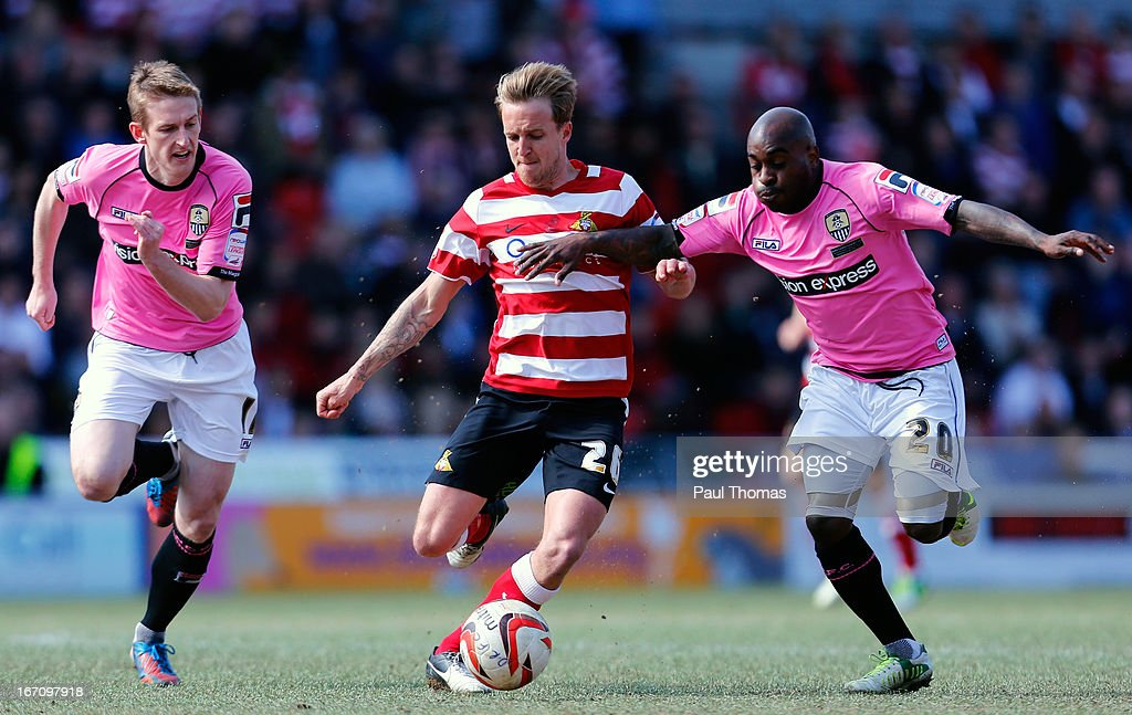 James Coppinger (C) of Doncaster in action with Jamal Campbell-Ryce of Notts County during the npower League One match between Doncaster Rovers and Notts County at the Keepmoat Stadium on April 20, 2013 in Doncaster, England.